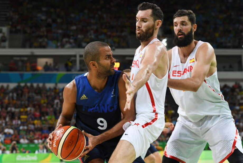 France's point guard Tony Parker (L) is blocked by Spain's small forward Rudy Fernandez during a Men's quarterfinal basketball match between Spain and France at the Carioca Arena 1 in Rio de Janeiro on August 17, 2016 during the Rio 2016 Olympic Games. / AFP PHOTO / Mark RALSTONMARK RALSTON/AFP/Getty Images Photo: MARK RALSTON/AFP/Getty Images