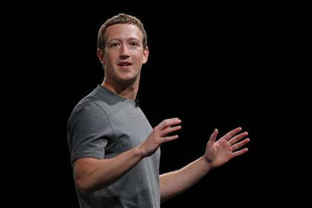 This Feb. 21, 2016, file photo shows Facebook CEO Mark Zuckerberg speaking during the Samsung Galaxy Unpacked 2016 event in Barcelona, Spain. Some of Zuckerberg's neighbors are grumbling about a rock wall he's having built on his property on Kauai's north shore. Retiree Moku Crain said Tuesday, June 28, 2016, the wall looks daunting and forbidding. Crain hopes and expects Zuckerberg will soften the wall's look by planting foliage around it. The wall began going up about four to six weeks ago. It runs along the property next to a road in the semi-rural community of Kilauea. (AP Photo/Manu Fernadez)