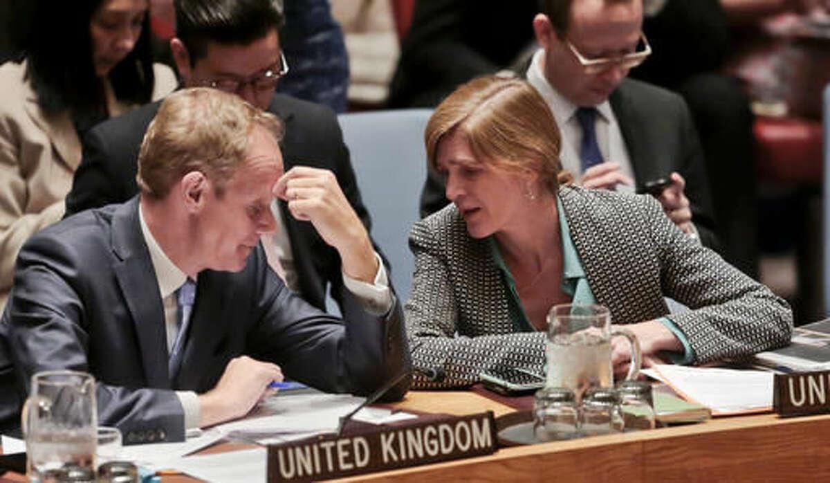 Britain's U.N. Ambassador Matthew Rycroft, left, and United States U.N. Ambassador Samantha Power, right, confer during a Security Council meeting on terrorism, Wednesday May 11, 2016 at U. N. headquarters. (AP Photo/Bebeto Matthews)