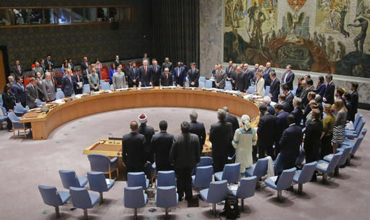 Participants in a Security Council meeting on terrorism, stand in a moment of silence for victims of terrorism world-wide, Wednesday May 11, 2016 at U. N. headquarters. (AP Photo/Bebeto Matthews)