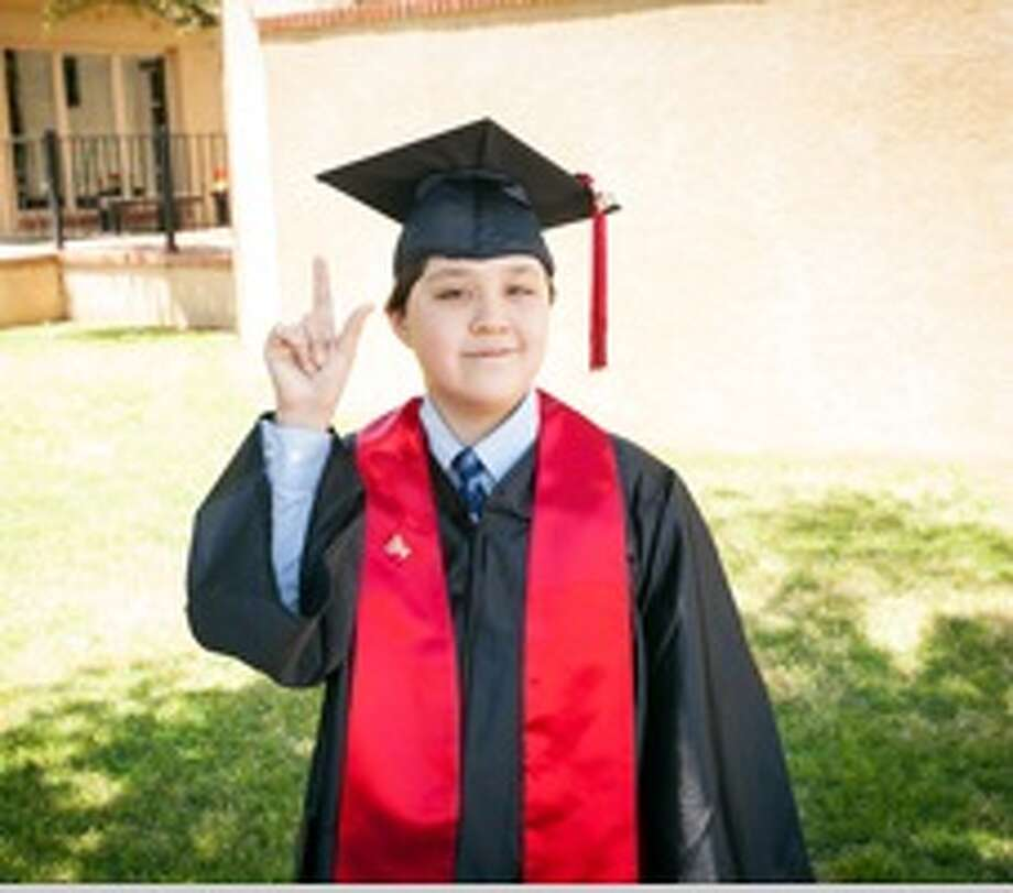 Jeremy Shuler, 12, graduated with his high school diploma from Texas Tech University Independent School District. Jeremy is attending Cornell University in the fall. Photo: Shuler Family