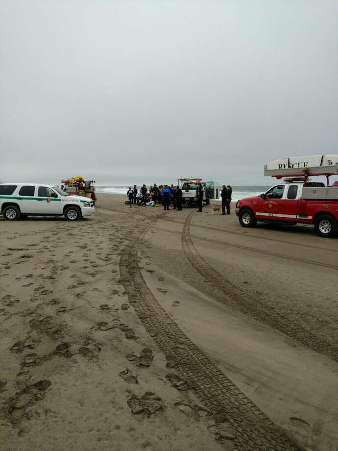 A woman believed to be in her 40s was in critical condition Wednesday after she was pulled from the waters off San Francisco's Ocean Beach and revived by paramedics. Photo: SFFD / /