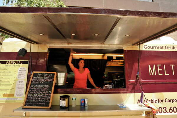 Co-owner Darlene Andersen waits for customers at the Melt Mobile food truck stationed at Veterans Park in Stamford, Conn., on Wednesday, June 3, 2015. Rob Forti is organizing a Food Truck Rodeo and Music Festival to take place on June 20th at Mill River Park featuring 16 food trucks, live music and a craft beer area.