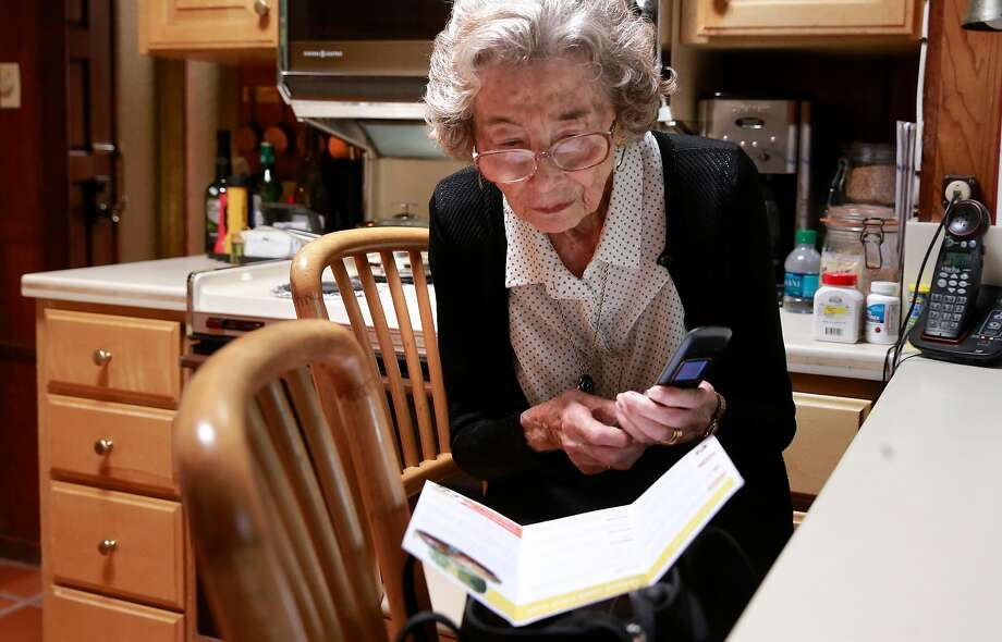 Ursula Moore dials the number to Go Go Grandparent which will arrange an UBER car for her to  take her to her appointments in Palo Alto, California, on Wed. Aug. 17, 2016. Photo: Michael Macor, The Chronicle