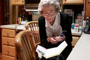 Ursula Moore dials the number to Go Go Grandparent which will arrange an UBER car for her to  take her to her appointments in Palo Alto, California, on Wed. Aug. 17, 2016.