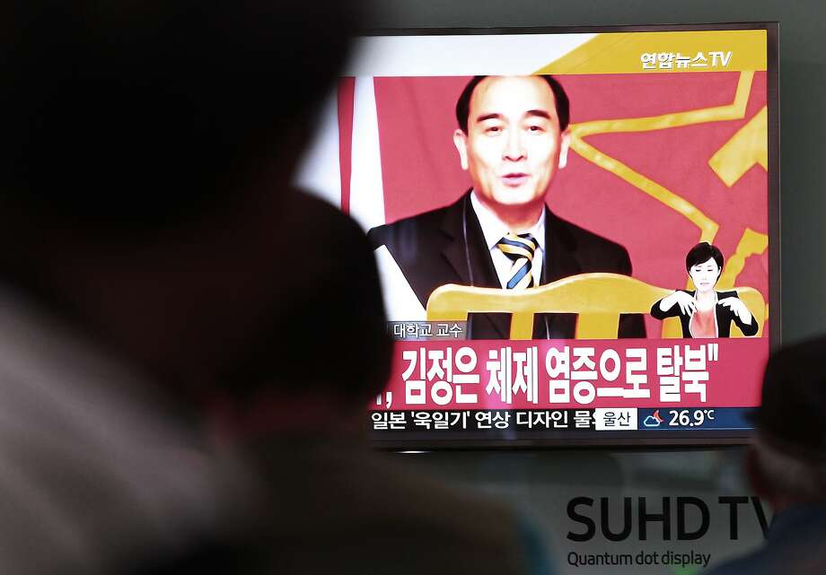 People in Seoul watch a TV news report showing the image of North Korean defector Thae Yong Ho. Photo: Ahn Young-joon, Associated Press
