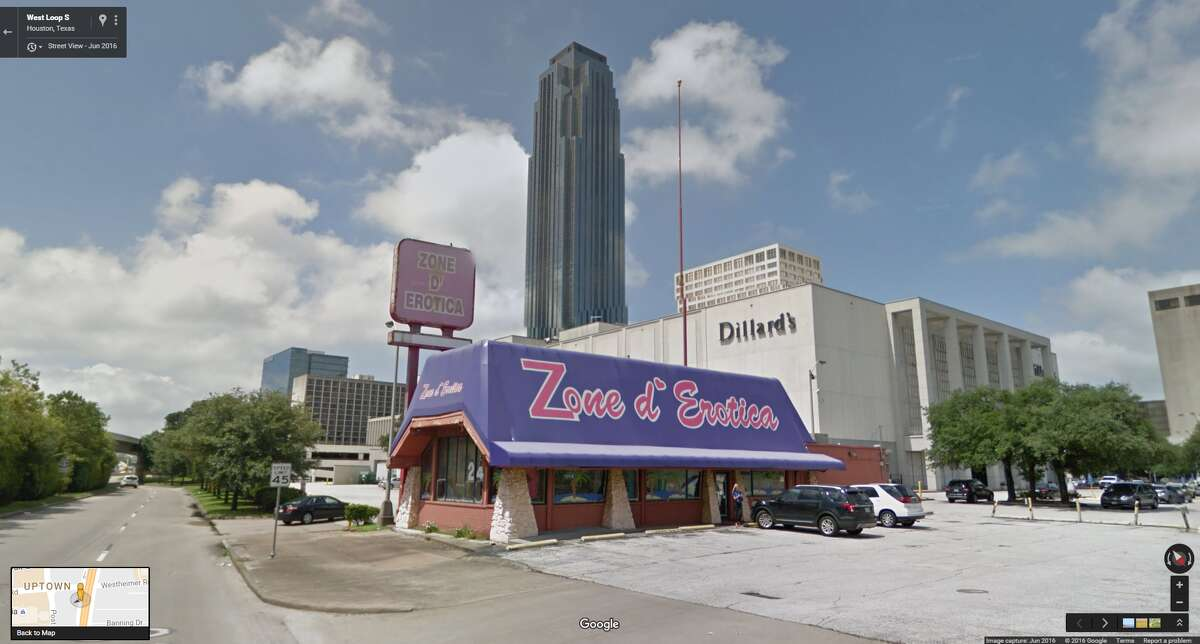 PHOTOS: Zoning oddities   West Loop South A sex shop, now closed, sits beside a crowded intersection next to Houston's third largest building.   >>Here are more examples of how lax zoning laws affect the cityscape...