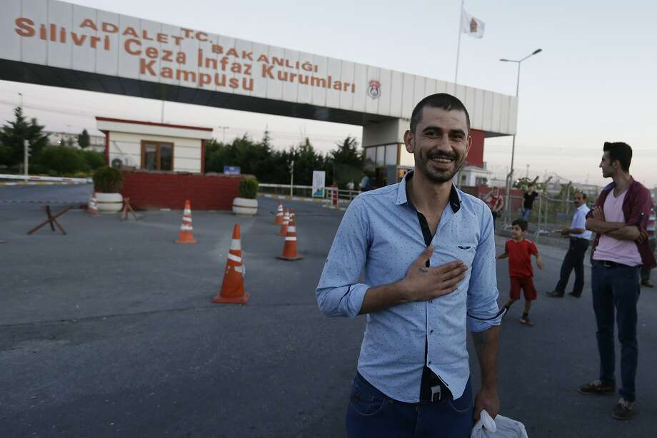 Emrah Pasa Alissoy leaves a high-security prison in Silivri, Turkey. Nearly 40,000 prisoners are expected to be freed to make way for people arrested in the coup. Photo: Thanassis Stavrakis, Associated Press