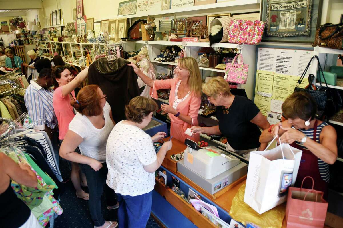 A large crowd waits in line to pay for items at last year's re-opening at the Rummage Room in Old Greenwich. This year's reopening is scheduled for Monday Aug. 22. The Rummage Room is a non-profit thrift shop run by the women's fellowship at the First Congregational Church of Old Greenwich and has donated more than $4 million to charitable organizations over the last 50 years.