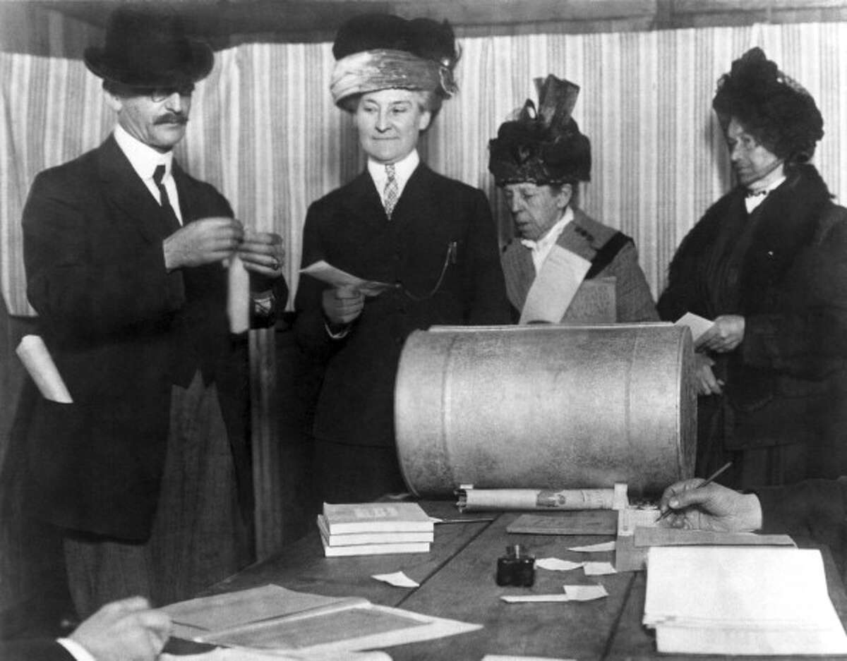 Three unidentified women make history by becoming the first of their sex to vote in an election after the 19th Amendment was passed, San Francisco, California, late 1910s or early 1920s. (Photo by Underwood Archives/Getty Images)