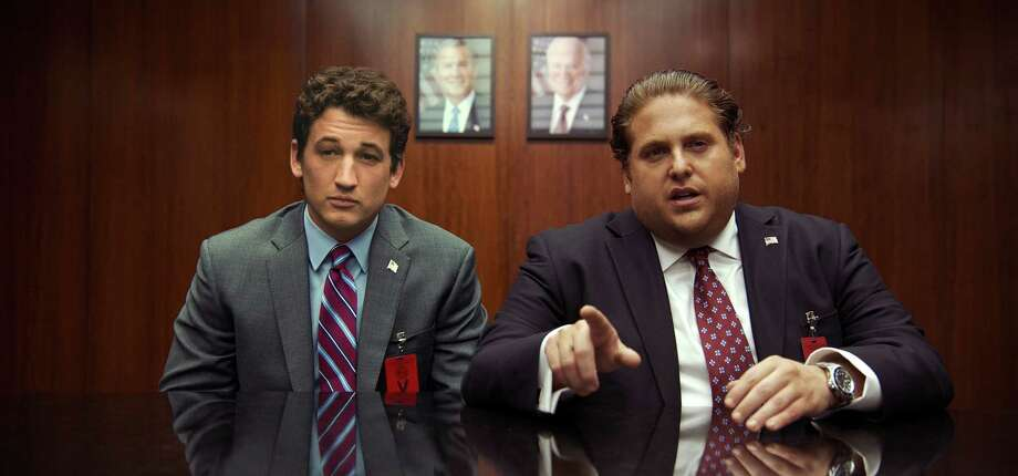 "This image released by Warner Bros. Pictures shows Miles Teller, left, and Jonah Hill in a scene from, ""War Dogs."" (Warner Bros. Pictures via AP) ORG XMIT: NYET118 / © 2015 Warner Bros. Entertainment Inc."