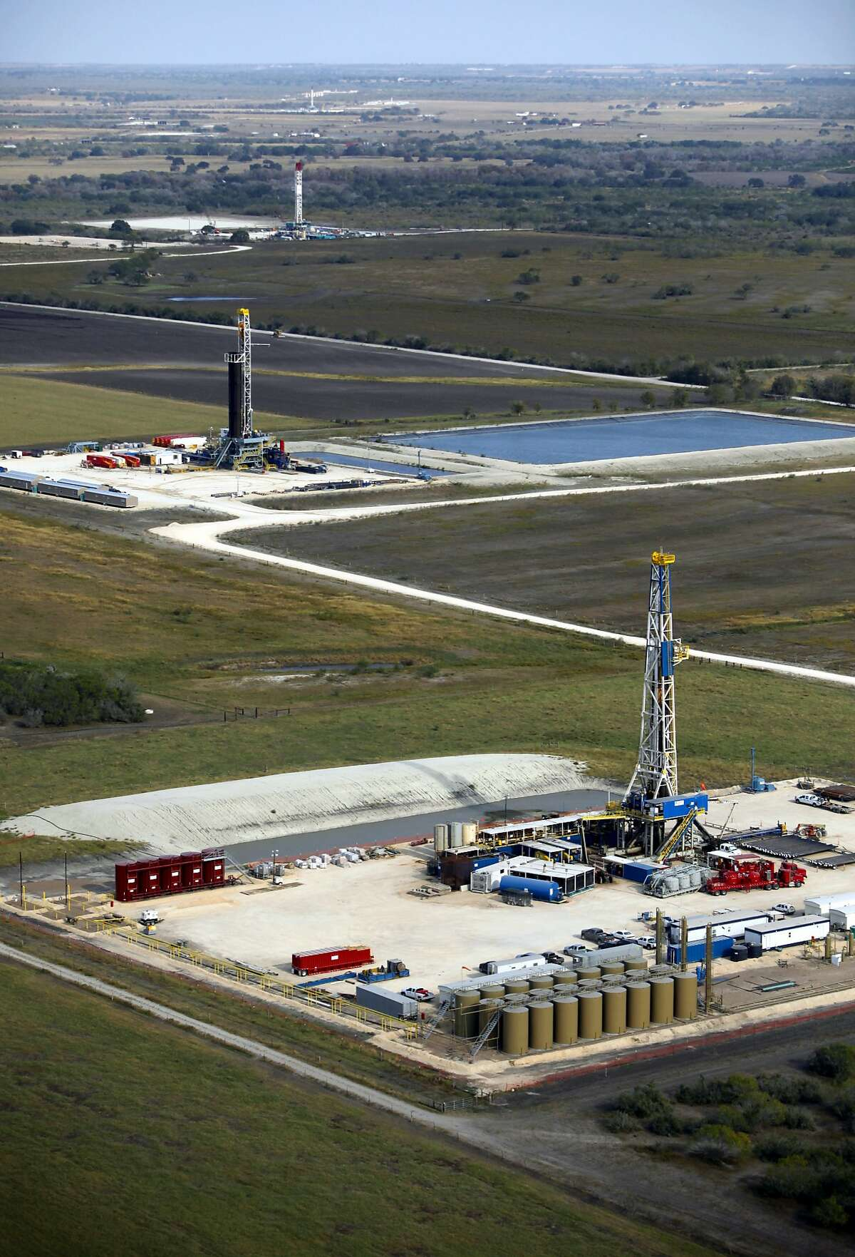 Drilling rigs in the Eagle Ford shale oil play are seen in this Friday Nov. 23, 2012 aerial photo.
