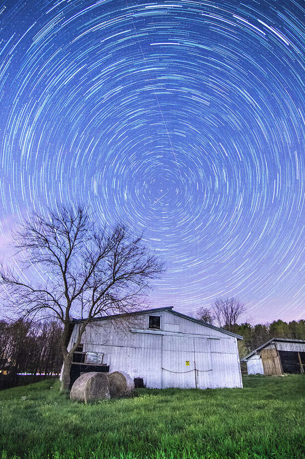 "The Gunnery in Washington has announced that Kenyon Kay of the class of 2018 has received second place overall in the Natural Gallery for the 2016 American Association of Physics Teachers (AAPT) High School Physics Photo Contest. Kenyon was recognized for his photo ""Bullseye Polaris,"" above. Jingqiong Miranda Yang of the class of 2017 was selected as one of the 100 photos for the final gallery for her photo, ""Reflections on Religion."" More than 1,000 photos submitted nationally each year to the AAPT photo contest and only 100 are selected. Students must submit an essay to go along with the photo that explains the physics behind the image. The students were assigned to take pictures in the advanced digital photography class at the private school. Photo: Courtesy Of The Gunnery / The News-Times Contributed"