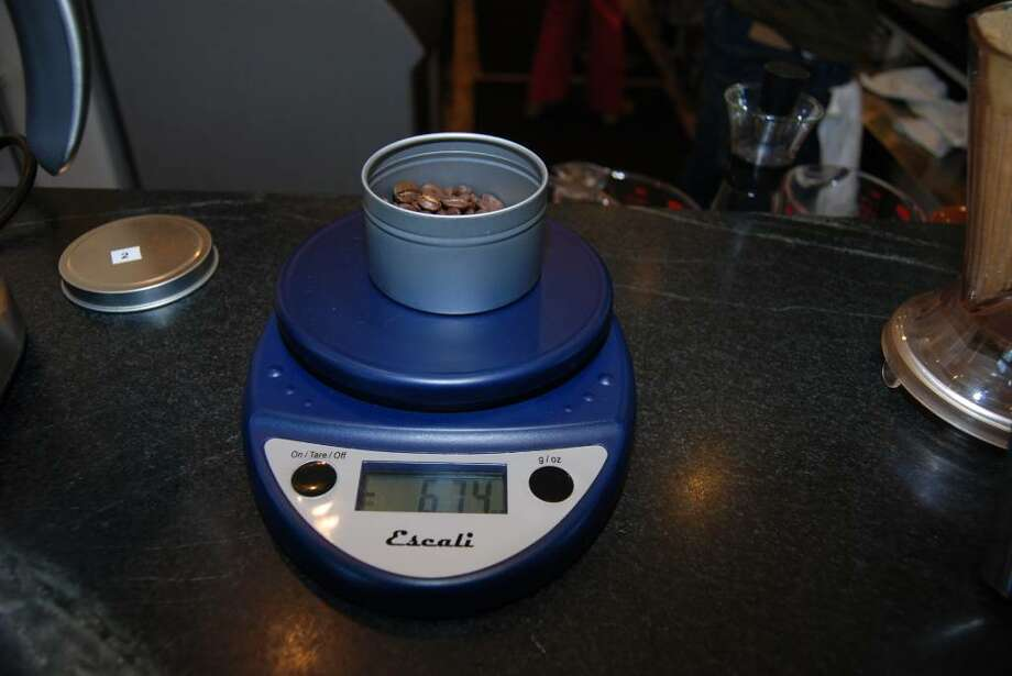 Step one: Weigh the beans. For one cup of Columbian coffee, you should use 25 grams (about 5 tablespoons). Photo: Jeanna Petersen Shepard / Darien News