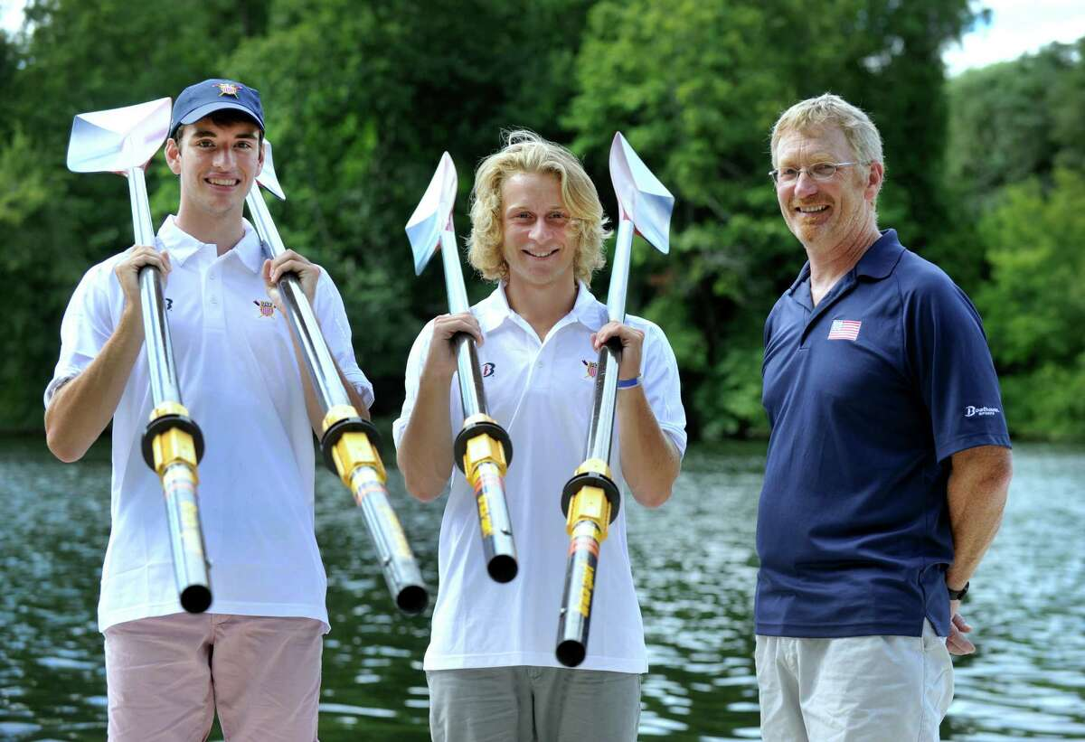 Jeffrey Schlyer, 16, left, and Conor Donadio, 17, center, both of New Milford, with their coach, Guenter Beutter of Wilton, on Wednesday. The Two New Milford High School students are competing in the 2016 World Rowing Junior Championships in Rotterdam, Netherlands, from Aug. 21 to 28.