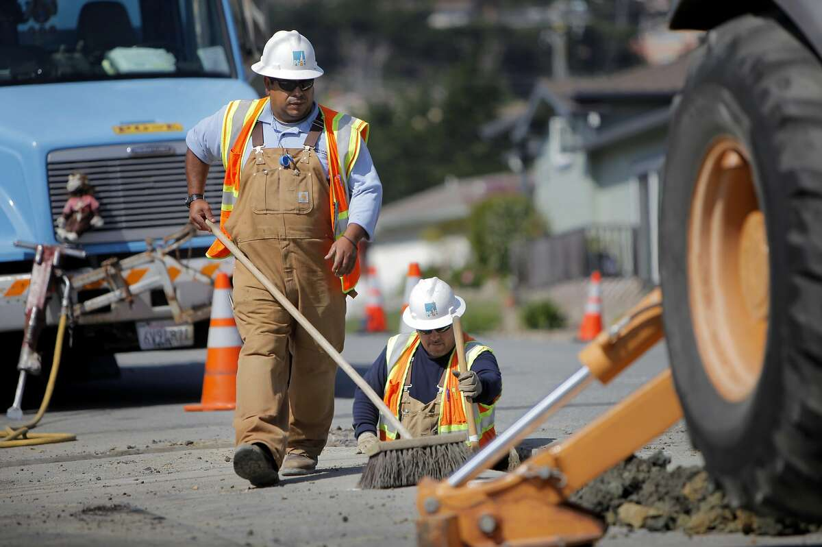 FILE-- PG&E workers dig up the intersection of Glenview and Claremont to place the distribution gas lines, Wednesday August 31, 2011, to the homes that were destroyed in the pipeline explosion in San Bruno.