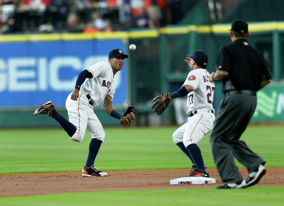 The Astros' star duo of Carlos Correa (left) and Jose Altuve will get to play before a national TV audience on ESPN when the Cubs visit Sept. 11. Photo: Karen Warren, Houston Chronicle / © 2016 Houston Chronicle