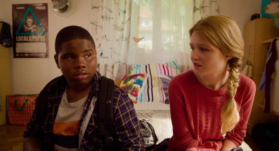 Markees Christmas (with Lina Keller) plays Morris, who moves to Germany with his father. Photo: A24