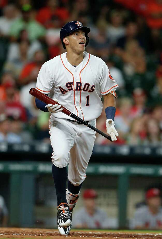 Houston Astros Carlos Correa (1) watches his ball line out to St. Louis Cardinals right fielder Stephen Piscotty during the eighth inning of an MLB game at Minute Maid Park,Wednesday, Aug. 17, 2016, in Houston. Photo: Karen Warren, Houston Chronicle / © 2016 Houston Chronicle
