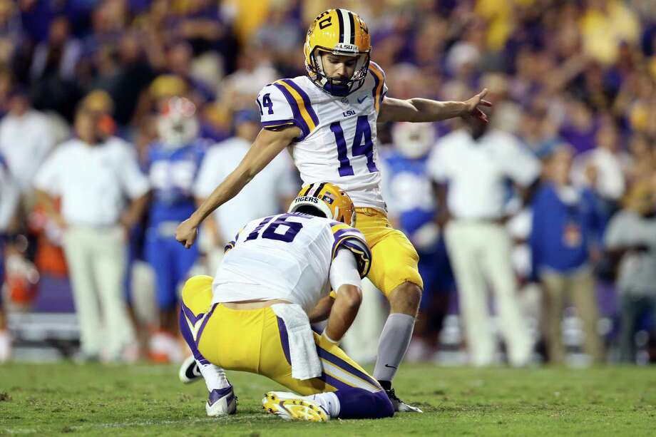 Trent Domingue of the LSU Tigers kicks an extra point after scoring his own touchdown on a fake field goal against the Florida Gators at Tiger Stadium on Oct. 17, 2015 in Baton Rouge, Louisiana. Photo: Chris Graythen /Getty Images / 2015 Getty Images