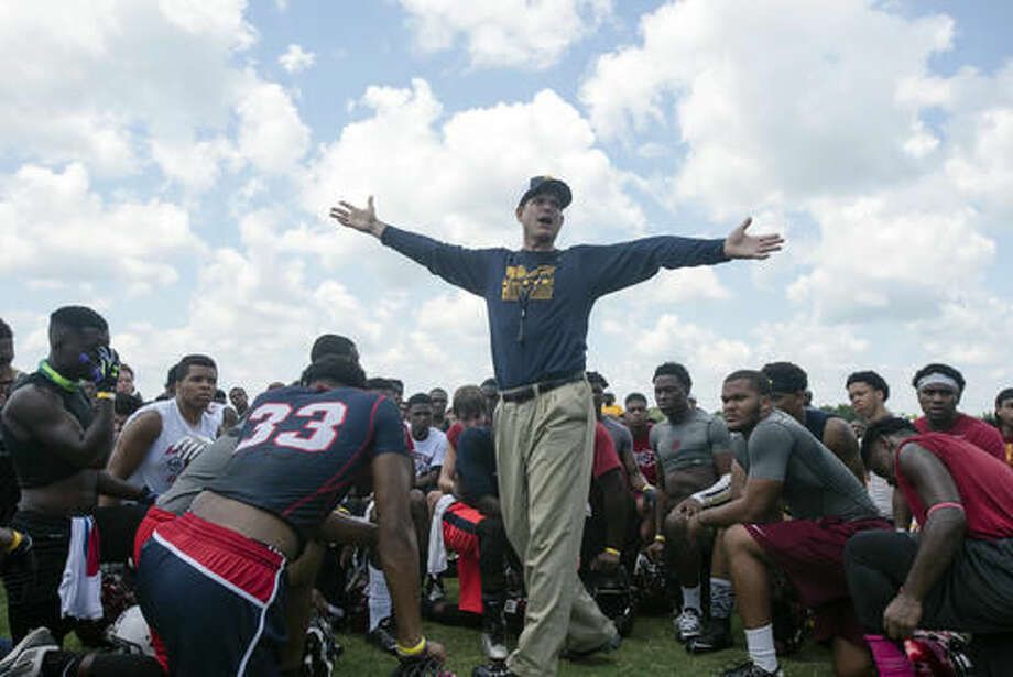 FILE - In this June 5, 2015, file photo, Michigan head coach Jim Harbaugh speaks to participants during the Coach Jim Harbaugh's Elite Summer Football Camp, at Prattville High School in Prattville, Ala.  (Albert Cesare/The Montgomery Advertiser via AP, File) Photo: Albert Cesare