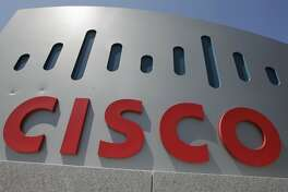 FILE - This Wednesday, May 9, 2012, file photo, shows an exterior view of Cisco Systems Inc. headquarters in Santa Clara, Calif. Cisco Systems Inc. reported Wednesday, Aug. 17, 2016, that it will lay off 5,500 employees as the internet gear maker scrambles to adapt to technology changes that have reduced demand for its main products. (AP Photo/Paul Sakuma, File)