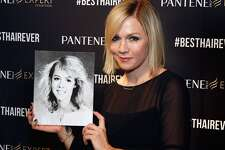 No stranger to 90s hair, Actress Jennie Garth shows off her high school yearbook photo and celebrates her best hair ever at the Pantene Expert reunion event on December 13, 2014 in Phoenix, Arizona.