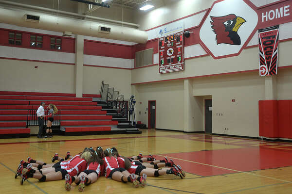Bridge City's varsity rally before facing Lumberton during Tuesday's volleyball match-up at Bridge City High School. Photo taken Tuesday, August 16, 2016 Kim Brent/The Enterprise
