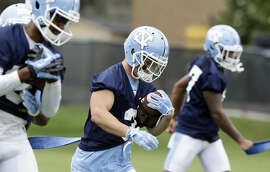 North Carolina wide receiver Ryan Switzer, center, runs through a drill during the team's first NCAA college football practice of the season in Chapel Hill, N.C., Friday, Aug. 5, 2016. (AP Photo/Gerry Broome)