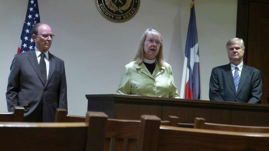 The Rev. Carol Morehead of St. Mark's Episcopal Church discusses the upcoming faith-based Pathways to Hope conference on mental health issues, during a news conference at the Bexar County Courthouse. Photo: John W. Gonzalez, Express-News Staff