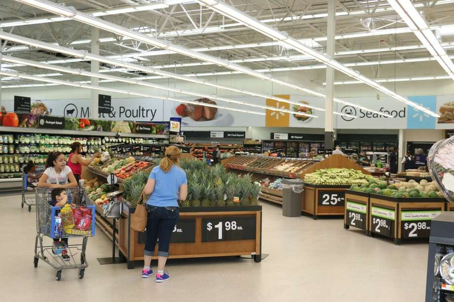 """Wal-Mart's unexpected growth was led by grocery sales and other household purchases. While some retailers have pointed to """"very cautious"""" shoppers in the latest slump, others cite consumer strength."""