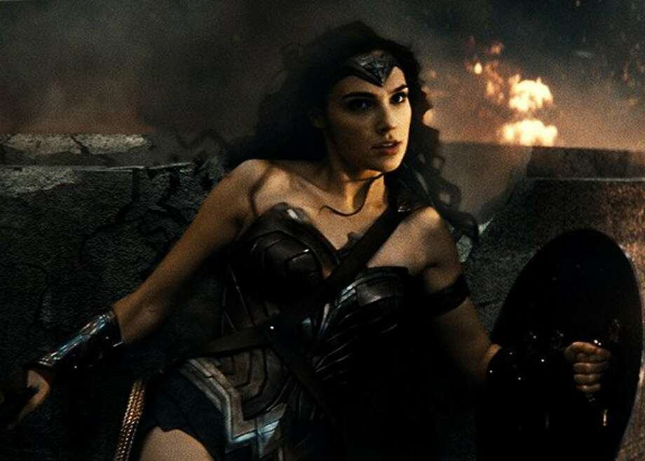 "The trailer for Patty Jenkins' ""Wonder Woman"" is stirring hope for the heretofore nigh-unwatchable DC Extended Universe. Gal Gadot's appearance as the Amazonian warrior was one of the rare highlights of ""Batman v Superman: Dawn of Justice"" (pictured here). But with so few opportunities for female filmmakers to craft tentpole movies, will too much be riding on the movie's success? Photo courtesy Warner Bros. Pictures. Photo: Warner Bros. Pictures"