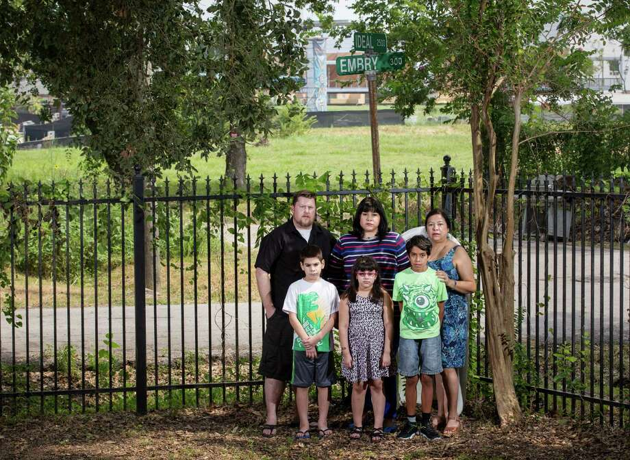 Karl Cavin, back row from left, his wife Theresa Cavin and her mother Valerie Gonzales, and front row from left, Austin Quintanilla, 9, his sister Hannah, 7, and their cousin Andrew Para, 9, pose for a photo Saturday, Aug. 13, 2016, in Houston. The group live in two neighboring houses across the bayou from the White Oak Music Hall, and they say the loud outdoor concerts are causing problems for them.  ( Jon Shapley / Houston Chronicle ) Photo: Jon Shapley, Staff / © 2015  Houston Chronicle