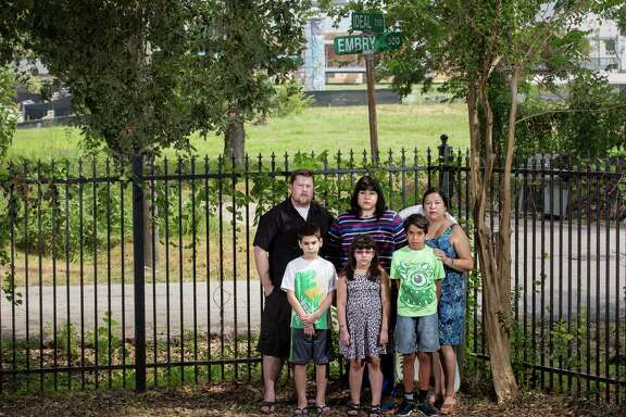 Karl Cavin, back row from left, his wife Theresa Cavin and her mother Valerie Gonzales, and front row from left, Austin Quintanilla, 9, his sister Hannah, 7, and their cousin Andrew Para, 9, pose for a photo Saturday, Aug. 13, 2016, in Houston. The group live in two neighboring houses across the bayou from the White Oak Music Hall, and they say the loud outdoor concerts are causing problems for them.  ( Jon Shapley / Houston Chronicle )