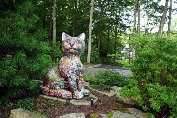 A sculpture of a cat, which was used in the Art in Public Places display in downtown Stamford in 2010, sits in front of the 6,300 square-foot home of deceased owner Lorna Jorgenson Wendt, in Stamford, Conn., on Tuesday, August 16, 2016.