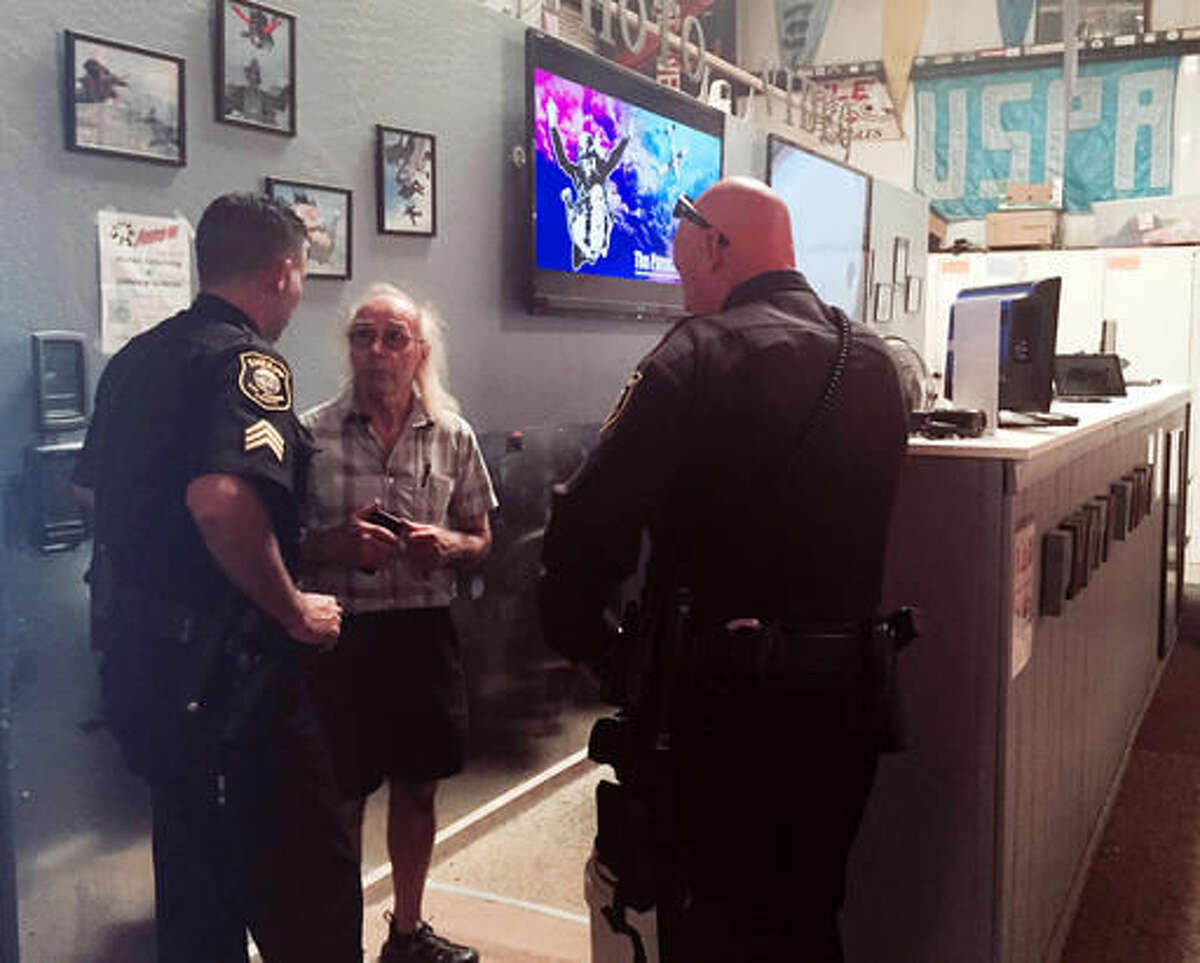 FILE - In this Saturday, Aug. 6, 2016 photo, San Joaquin County Sheriff's deputies talk with Bill Dause, the owner of the Lodi Parachute Center in Lodi, Calif., some 85 miles east of San Francisco, after two skydivers had died when they plummeted to the ground earlier in the day. One was 18 and jumping for the first time, and his family was there watching when he hit the ground, Dause and local authorities said Sunday. Another deadly skydiving incident at the Lodi Parachute Center was confirmed Sunday.