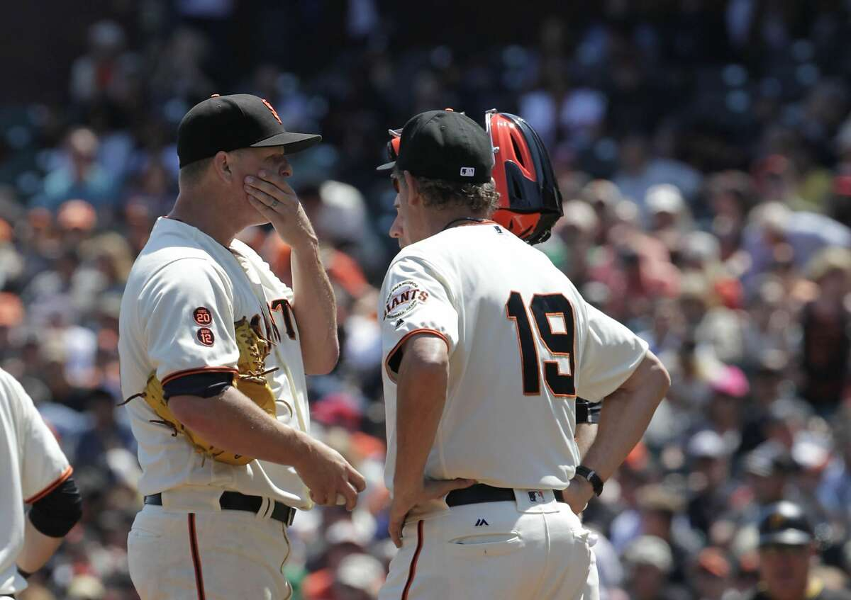 Giants pitching coach Dave Righetti (right) talks with starting pitcher Matt Cain (left) after Cain walked the bases loaded against the Pittsburgh Pirates in the top of the fifth inning as the San Francisco Giants play the Pittsburgh Pirates on Wednesday, August 17, 2016 in San Francisco, California.�Final Score: Pittsburgh Pirates: 6 San Francisco Giants: 5