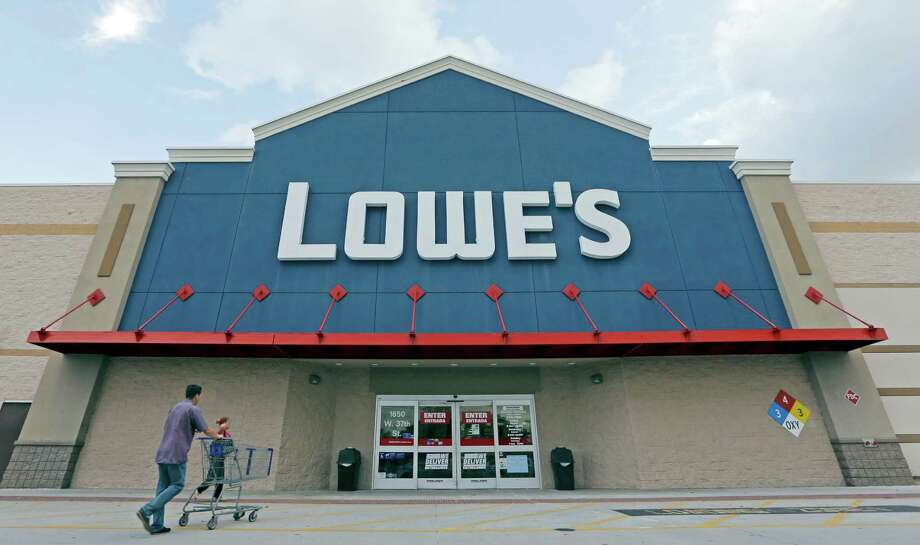 Customers walk toward a Lowe's store in Hialeah, Fla. The company says it plans to close 20 stores in the U.S. and another 31 outside the country.(AP Photo/Alan Diaz) ORG XMIT: NYBZ301 Photo: Alan Diaz / Copyright 2016 The Associated Press. All rights reserved. This m