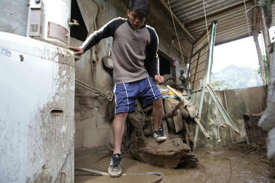 A resident inspects damage to his house affected by a mudslide in Xaltepec, Mexico, Monday, Aug. 8, 2016. Mountain communities in two Mexican states are recovering from weekend mudslides that killed dozens during heavy rains brought by remnants of Hurricane Earl. (AP Photo/Pablo Spencer) Photo: Pablo Spencer