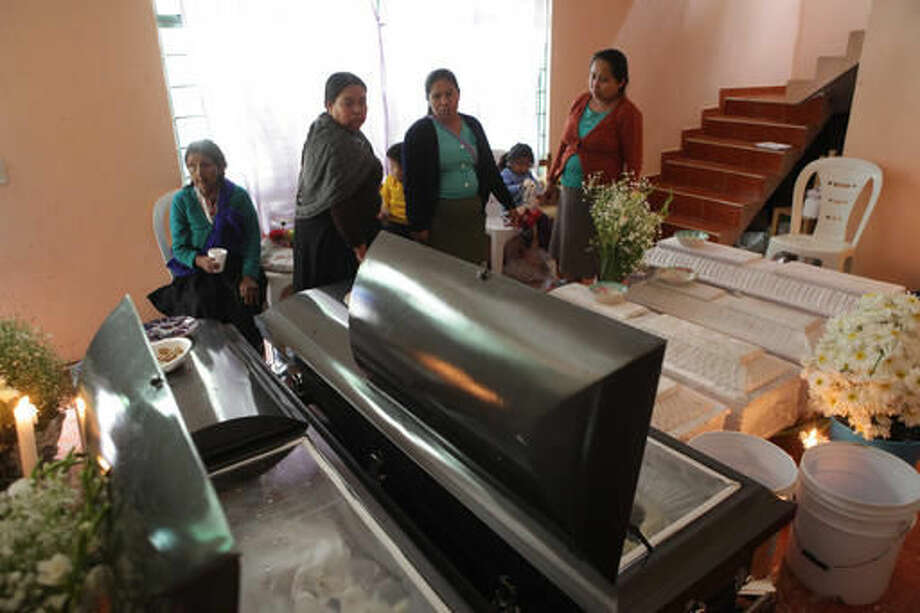 Relatives attend a funeral service for the Perez Vasquez family that was killed by a mudslide, in Xaltepec, Mexico, Monday, Aug. 8, 2016. Mountain communities in two Mexican states are recovering from weekend mudslides that killed dozens during heavy rains brought by remnants of Hurricane Earl. (AP Photo/Pablo Spencer) Photo: Pablo Spencer
