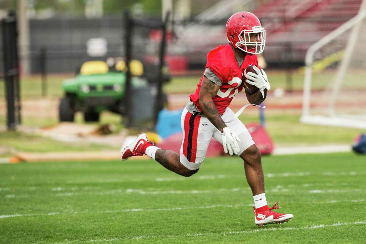 Houston running back Duke Catalon (31) runs with the football during the Cougars' opening spring practice Monday, March 7, 2016, in Houston. ( Brett Coomer / Houston Chronicle )
