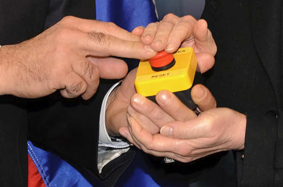 """In March 2009, Secretary of State Hillary Clinton gave her Russian counterpart, Foreign Minister Sergei Lavrov, a """"reset"""" button. Photo: Fabrice Coffrini"""