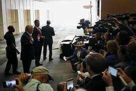Donald Trump, 2016 Republican presidential nominee, left, speaks to the media before a town hall event in Columbus, Ohio, U.S., on Monday, Aug. 1, 2016. Trump's swipe at the heartbroken parents of a Muslim-American war hero killed in Iraq has sparked condemnation across party lines, prompting top Republicans in Congress to distance themselves from the GOP presidential nominee. Photographer: Luke Sharrett/Bloomberg