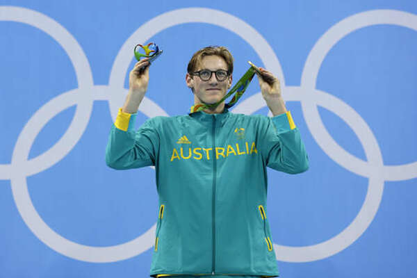 Australia's gold medal winner Mack Horton celebrates on the podium during the ceremony for the men's 400-meter freestyle final during the swimming competitions at the 2016 Summer Olympics, Saturday, Aug. 6, 2016, in Rio de Janeiro, Brazil. (AP Photo/Michael Sohn)