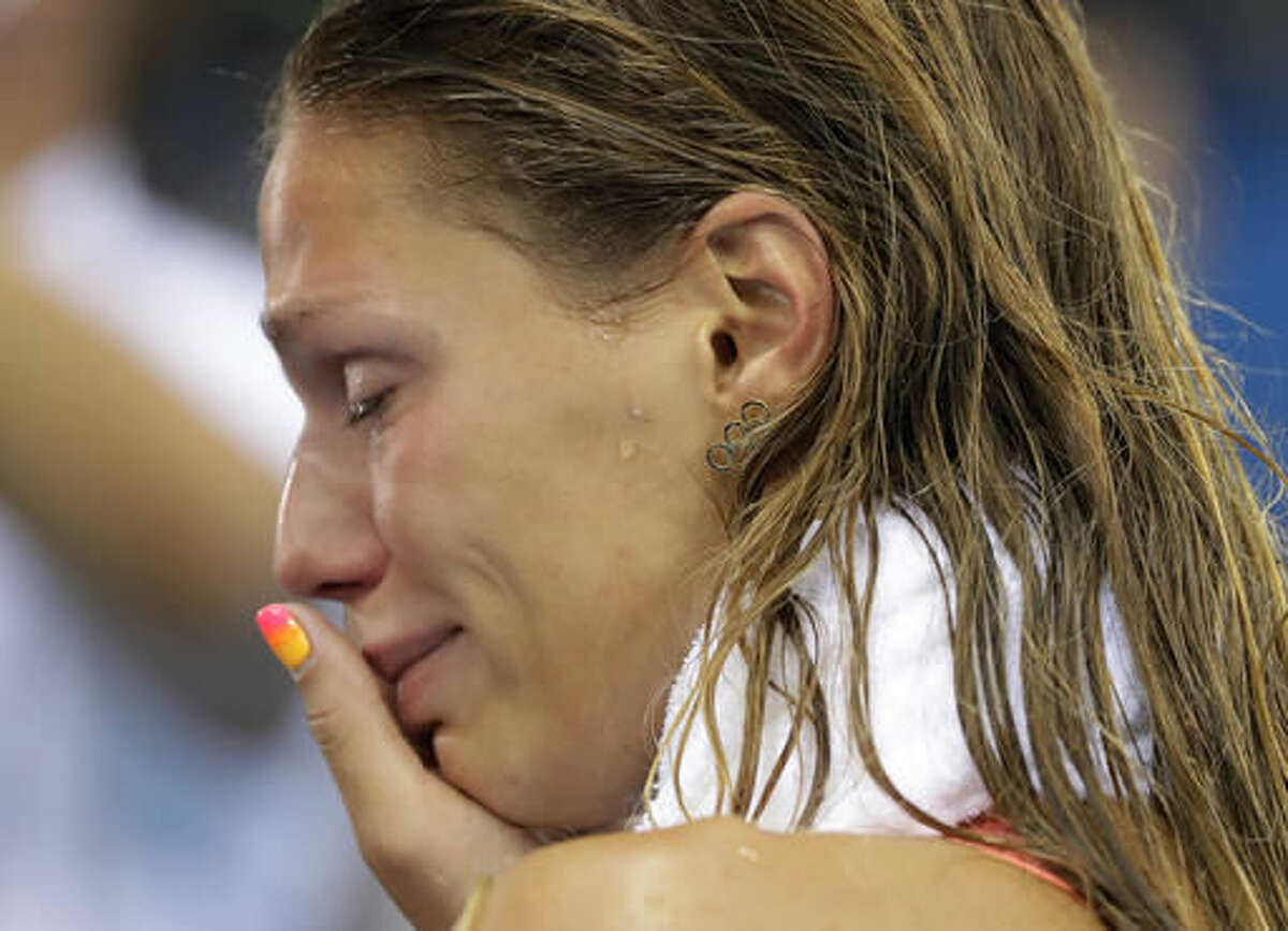 Russia's Yulia Efimova cries after placing second in the women's 100-meter breaststroke final during the swimming competitions at the 2016 Summer Olympics, Monday, Aug. 8, 2016, in Rio de Janeiro, Brazil. (AP Photo/Matt Slocum)