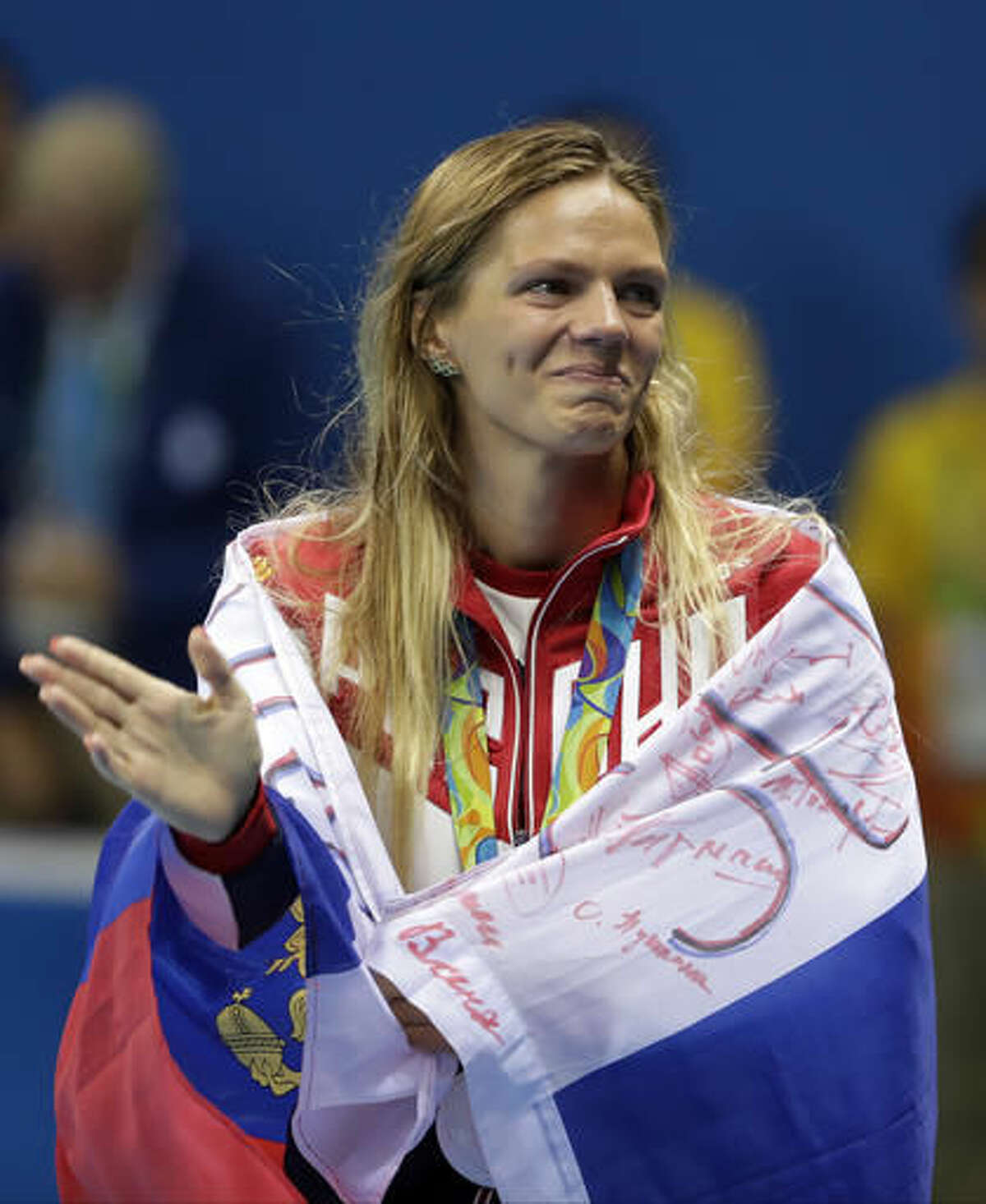 Russia's silver medal winner Yulia Efimova waves during the medal ceremony for the women's 100-meter breaststroke during the swimming competitions at the 2016 Summer Olympics, Tuesday, Aug. 9, 2016, in Rio de Janeiro, Brazil. (AP Photo/Matt Slocum)