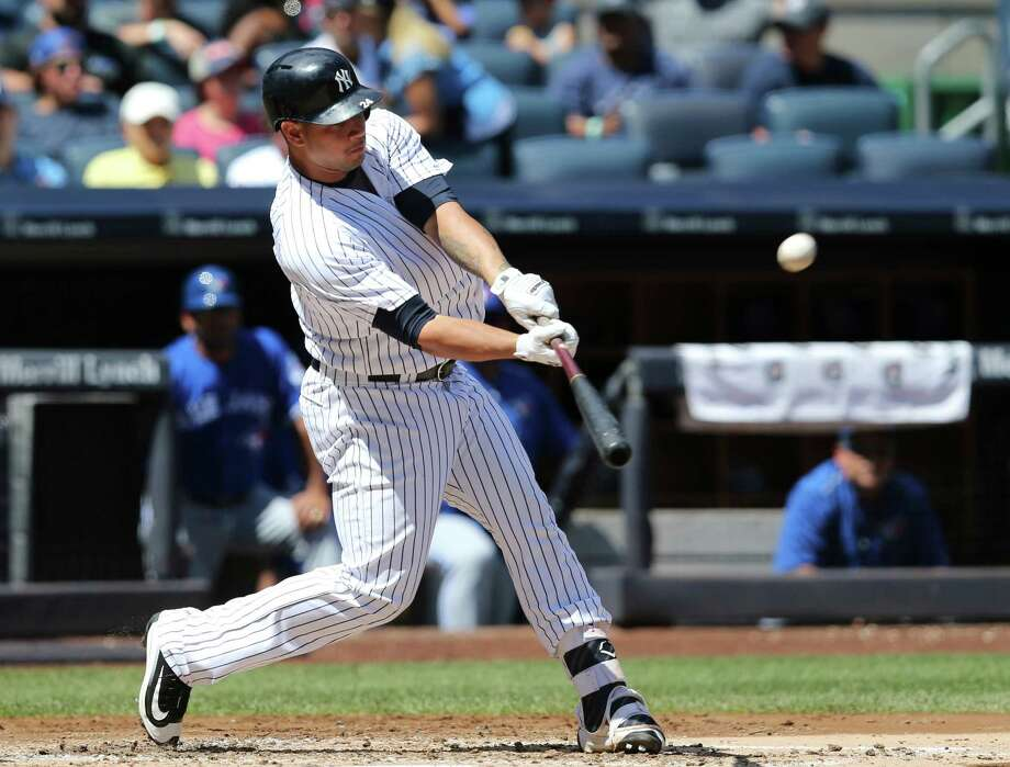New York Yankees' Gary Sanchez hits a solo home run during the second inning of a baseball game against the Toronto Blue Jays at Yankee Stadium, Wednesday, Aug. 17, 2016 in New York. (AP Photo/Seth Wenig) ORG XMIT: NYSW105 Photo: Seth Wenig / Copyright 2016 The Associated Press. All rights reserved. This m