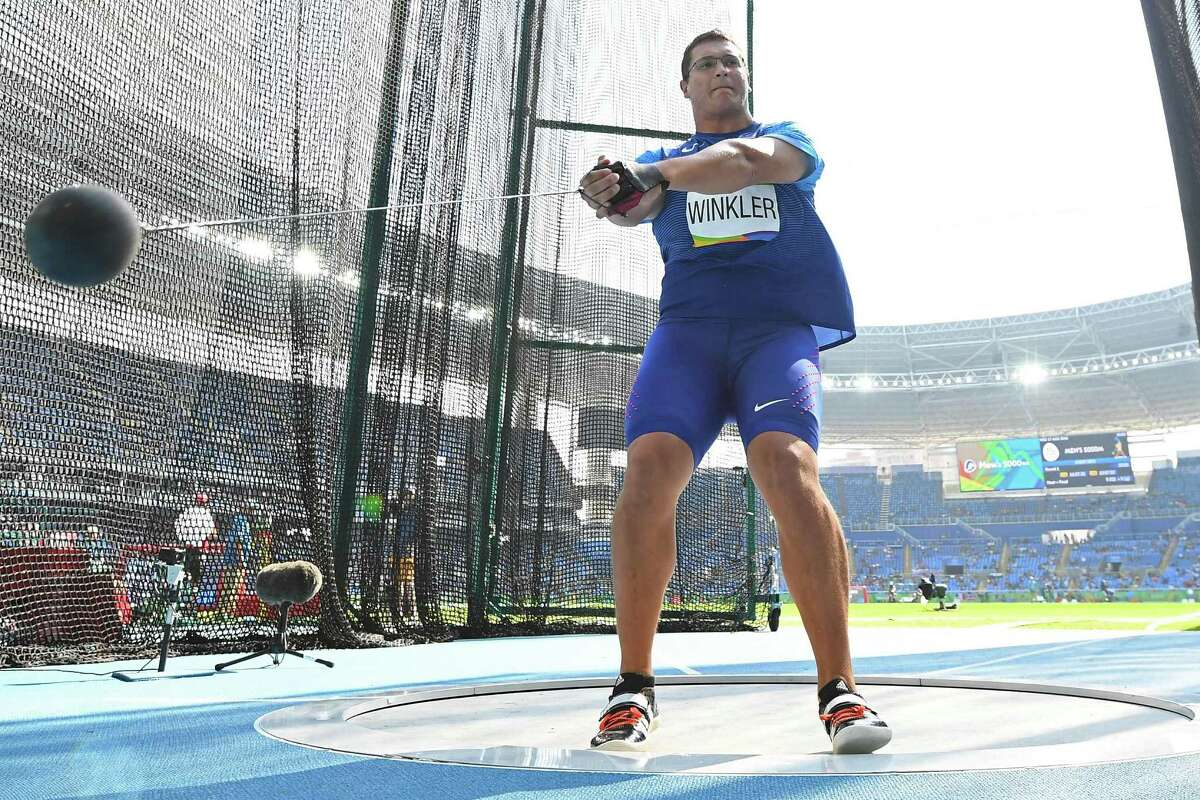 USA's Rudy Winkler competes in the Men's Hammer Throw Qualifying Round during the athletics event at the Rio 2016 Olympic Games at the Olympic Stadium in Rio de Janeiro on August 17, 2016. (AFP PHOTO / FRANCK FIFE)
