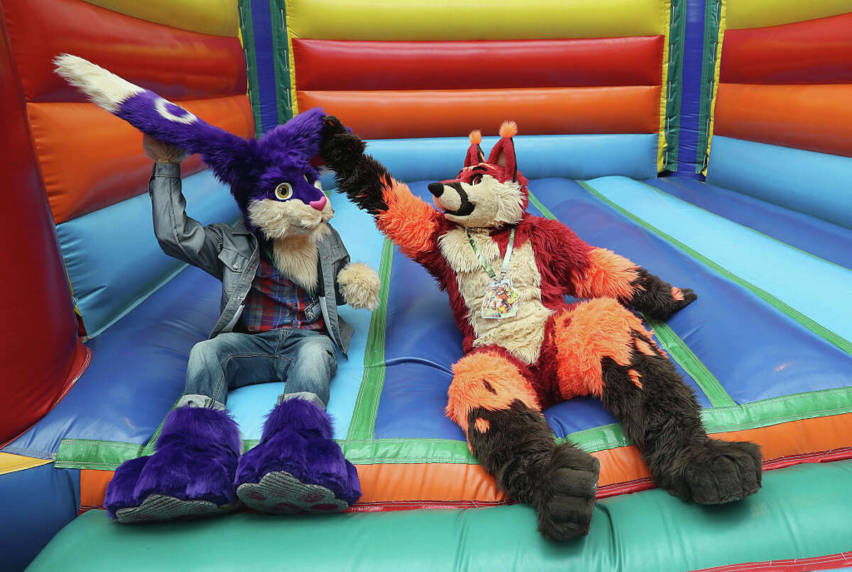 Two participants, or furries, as they prefer to be called, sit in an inflatable jumping castle at the Estrel Hotel on the first day of the 2016 Eurofurence furries gathering on August 17, 2016 in Berlin, Germany. Approximately 2,500 furries from all over the world will participate in the four-day convention that includes dance parties, fashion shows and art events.Furries describe themselves as anthropomorphic actors and the movement has its roots in science fiction and fantasy genres going back to the 1980s.