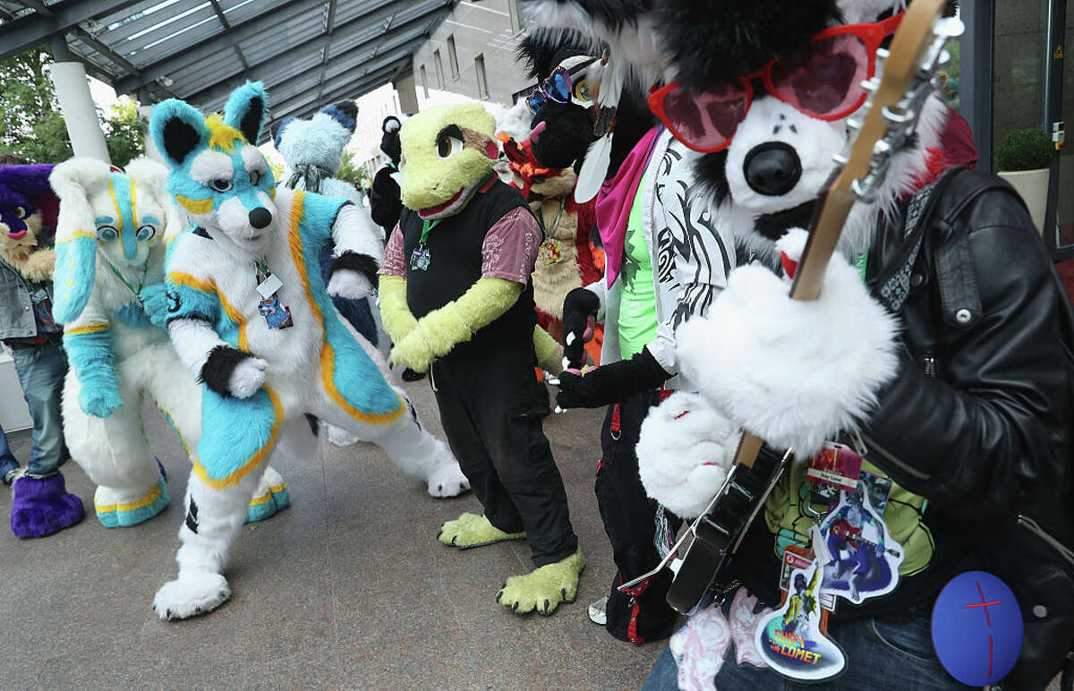 FILE - Participants, or furries, at a 2016 convention in Berlin.